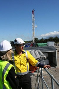 Shane and Alex at the Cheal A-Site, with the Rival Rig #1 in the background for workover.