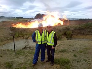 """Lead engineer Jack Doyle and CEO Garth Johnson, in front of the Cheal-C2 discovery well. This important step-out well in TAG's C-block discovery area flow tested ~14 million cubic feet per day (~2,333 BOE/day) on a 48/64"""" choke, with associated condensate production increasing during testing. Located about 3.5 km's NW of TAG's Cheal-B5 well, it significantly extends the known oil-and-gas saturation area within TAG's Cheal permit. The success of Cheal-C2 also adds another high-impact target to TAG's prospect portfolio in the Mt. Messenger and Urenui formations."""