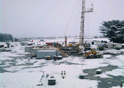 Ensign 6 service rig at the Cheal-C1 well, tests the multiple oil and gas bearing zones amidst a rare snowfall.